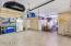 2 Car garage, Epoxy Floors, Built in Cabinets, overhead storage and additional storage space