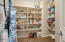 Walk in pantry with convenient storage and access