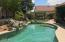 Sparkling Pebble tec pool with water feature in Resort back yard!