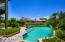 Exquisite mother of pearl tiled pool and spa.