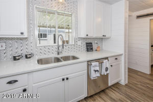 So much bling! Glass and metal tile backsplash and sparkling Quartz