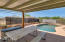 Pool with covered patio area.
