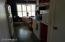 Looking from the hallway into the kitchen, to the breakfast area. Attractive Concrete floors are easy to maintain.