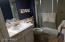 Private master bath has a walk-in shower.