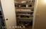 Hallway linen closet has plenty of room for supplies.