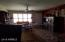 Looking from the dining room toward the front door, you see how much natural light comes in through that large from picture window.