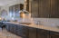 Gas cooktop and stainless steel hood. Quarts countertops.