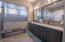 Master bath with double sinks, upgraded quartz, lighting, fixtures.
