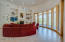 Great Room with Wall of Glass, Expansive Mountain Views, 16' Ceilings, Gas Fireplace and Architectural Niches.