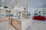 Kitchen with Maple Cabinetry, Double Ovens, Cooktop, Oversized Refrigerator/Freezer, Island with Breakfast Bar, Granite Countertops and Walk in Pantry.
