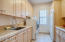 Laundry Room with Plenty of Cabinets and Countertop Space, Drip Dry Station and Regrigerator.
