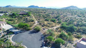 Situated at the end of a private and quiet cul-de-sac, this 2.39 acre property boasts stunning unobstructed sweeping mountain and City light views and represents 2 of the last 3 remaining lots in the subdivision. Build your dream home atop one of the prime high points and enjoy picturesque sunsets and soak in the natural beauty of the Sonoran Desert that surrounds you. Minutes to Scottsdale National Golf Club, Pinnacle Peak, restaurants and numerous hiking trails. This is a prime piece of property to build on and is secluded deep within the subdivision amongst multi-million dollar properties. Plans available to build a 4,400 sf home. Sale includes APNs 216-74-111 and 216-74-118.