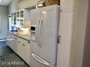 White galley Kitchen with plenty of storage