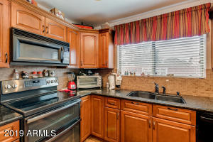 Remodeled kitchen w/upgraded cabinets, granite counters, black stainless appliances