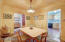 Formal Dining Room Which Flows From Living Room to Kitchen to Alcove & Hallway