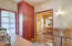 The Alcove with Built-Ins, a Door Leading to Side Exterior Courtyard, Master Bedroom & Dining Room