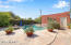 Part of Backyard with Heated Saltwater Pool & Spa Facing 2-Car Detached Garage