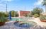 Backyard with Heated Saltwater Pool & Spa Facing 2-Car Detached Garage