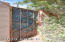 Front-side photo of Custom, Metal Gate in Backyard Made by the Renown Metal Artist, John H. Pearce