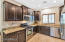 Upgraded kitchen offers staggered cabinetry, stainless appliances and the desirable gas range.