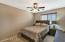 Offers a fan, wood blinds, carpet and slider closet.