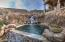 BOULDER WATERFALL CASCADES INTO DIVING POOL