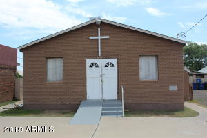 This church has been part of the Mesa community for over 70 years. It is centrally located on Center Street.  This  building houses the Trinity Bible Church. The church has an occupancy of 110 persons. There are two restrooms and 2 small offices. There is additional space in the basement that can be used for storage .  Adjacent to this building are two vacant lots, 521 and 525 N Center St are listed separately but will be sold with this property. Lot 525 is currently paved and is used as the parking lot for the church.* The personal property are not included in the sale*. The owners are however prepared  to negotiate the sale of all furniture, chairs and musical equipment through a Bill of Sale.
