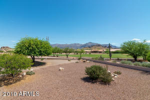 large back yard with mountain and golf course views!