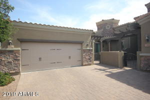 Single level townhome with gated front courtyard & shared driveway