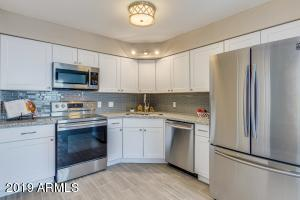 You'll love the updated kitchen with White Shaker Cabinets, Subway Tile Backsplash, SS Appliances, and So Much More!