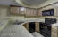 Large kitchen with upgraded cabinetry.