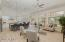Massive Great Room! Enormous windows look over your lush backyard with gorgeous trees, turf, pool, built in grill!