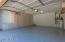 New expoxy garage flooring AND PLENTY OF CABINETS FOR STORAGE! TANKLESS WATER HEATER!!! HUGE UPGRADE IN WATER HEATERS!