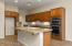 Kitchen with GE Monogram Appliances and Upgraded Cherry Cabinets