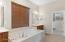 Master Bath Soaking Tub View to Walk-In Closet