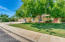 Beautiful mature landscaping with large shade trees in the expansive yard.