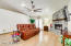 Gorgeous vaulted great room with large stone fireplace and new expansive ceiling fan