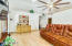 Large Great Room has plenty of room, vaulted ceiling and plant shelves