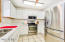 Light and bright kitchen features features upgraded stainless steel appliances