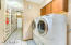 Large laundry room with huge extra storage area