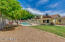 Nicely landscaped yard with mature landscaping
