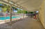 Expansive patio area with plenty of space for outdoor living by the pool