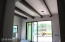 Formal living has wine cellar built in and wood beams. doors slide open to enjoy out door living