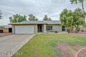 Pull up to this over sized cul-de-sac lot with gorgeous curb appeal!