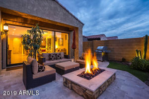 Beautiful backyard setting with built-in fire pit and view fence.