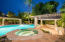 Heated Resort Style Pool with swim up bar, cabana, and plenty of lounging areas.