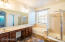 Stunning master bathroom with soaking tub, shower, private toilet room, and double sinks!