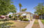 Charming Willo Bungalow with gated drive and oversized garage behind gate.