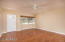 Large family room with beautiful bay window. New wood floors throughout.
