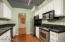 Stainless steel appliances. Kitchen opens to dining room.